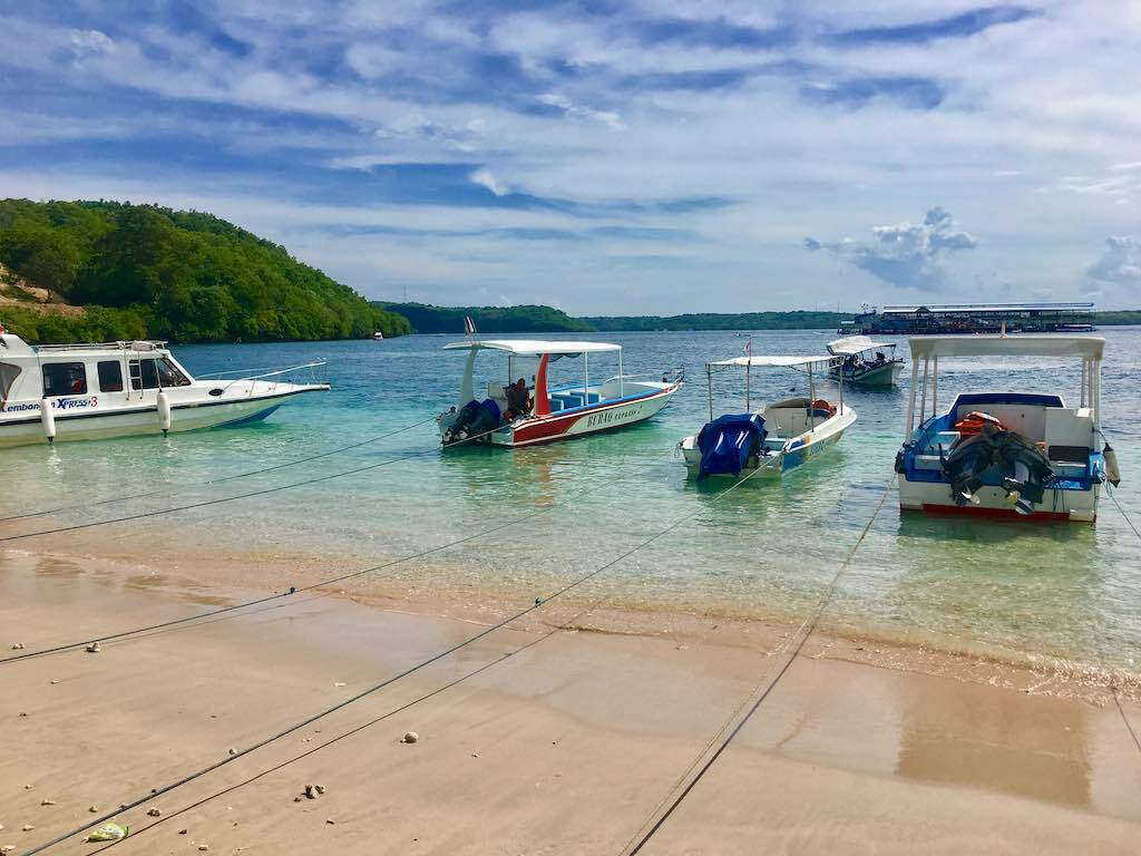 get around in Nusa Penida with a boat